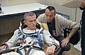 Astronaut Frank Borman talks with astronaut Alan Shepard.jpg
