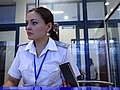 Attendant Processes Tickets in Main Train Station - Tashkent - Uzbekistan (7466949952).jpg