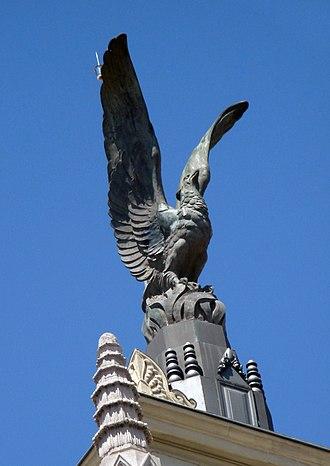Unión y el Fénix Español building - Phoenix bird on the top of the building.