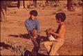BOYS WITH SCRAP IRON NEAR PHELPS DODGE CORP. SMELTER - NARA - 543991.tif