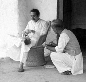 Meher Baba - Meher Baba dictating a message to a disciple in 1936 using his alphabet board