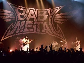 "Babymetal - Babymetal's backing band ""Kami Band"" performance at Danforth Music Hall on May 12, 2015. From left to right: BOH, Mikio Fujioka, Hideki Aoyama and Takayoshi Ohmura"