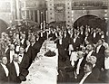 Banquet for scientists in the Tyrolean Alps at the 1904 World's Fair, 22 September 1904. (View of banqueters standing, most looking to the left).jpg