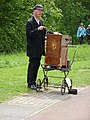 Barrel organ player, Beamish Home Farm tram stop, 5 June 2012.jpg