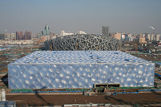 Beijing National Aquatics Center - The National Aquatics Center, with the Beijing National Stadium in the background