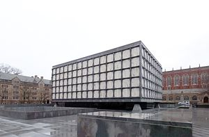 Beinecke Rare Book & Manuscript Library - This rainy day view shows the massive corner piers supporting the building's exterior enclosure. The sunken sculpture forecourt is in the foreground at left.