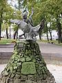 Belarus-Minsk-Boy Playing with Swan Sculpture-2.jpg