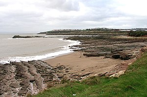 Barry Docks - The Bendricks looking west. The lighthouse at the entrance to the channel leading to the docks is just visible with Barry island on the skyline