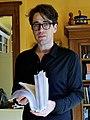 Benjamin Moser with a book manuscript (cropped).jpg