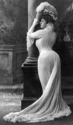 Bianca Lyons, full length, standing, facing le...