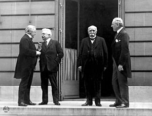 History of U.S. foreign policy - British prime minister Lloyd George, Italy's Vittorio Emanuele Orlando, France's Georges Clemenceau, and U.S. President Woodrow Wilson at the Treaty of Versailles in 1919. The settlement failed to secure a lasting peace since it punished Germany with brutal financial penalties.