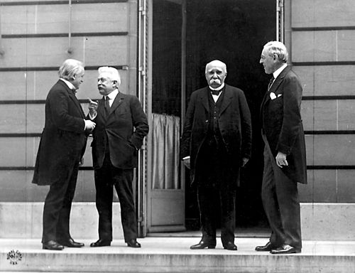 Italian Prime Minister Vittorio Emanuele Orlando (2nd from left) at the World War I peace negotiations in Versailles with David Lloyd George, Georges Clemenceau and Woodrow Wilson (from left) Council of Four Versailles.jpg