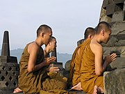 Buddhist pilgrims meditate on the top platform.