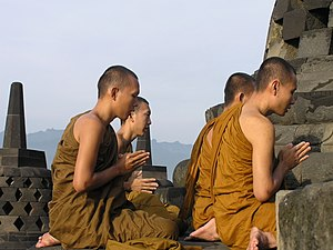 Buddhism in Indonesia - Monks praying at Borobudur, the largest Buddhist structure in the world, built by the Sailendra dynasty.