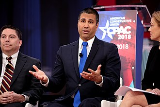 Net neutrality in the United States - FCC Chairman Ajit Pai (center) has been at the forefront of the recent rollback of net neutrality rules.