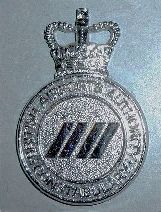 Airport policing in the United Kingdom - A cap badge of the British Airports Authority Constabulary.