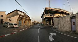 Broken well-house and the Tel Aviv Central Bus Station.jpg