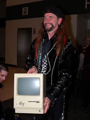 DigiBarn Computer Museum - Bruce Damer, cofounder and curator of DigiBarn poses with an early Macintosh signed by Steve Wozniak during Macworld Expo 2009