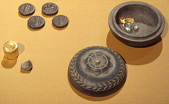 Sases - Buddhist reliquary with coinage, apparently of Sases. Sases inscribed a Buddhist triratna with his tamgha on some of his coins.