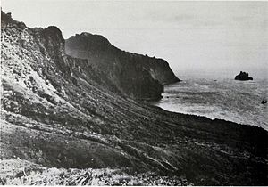 Gough Island - East coast of Gough Island with 115 m high Penguin Islet lying 0.8 km off the point.