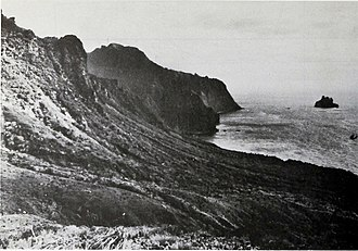 Gough Island - East coast of Gough Island with 115 m high Penguin Islet lying 0.8 km off the point