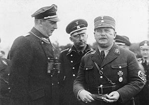 Michael Lippert - Ernst Röhm (right) with Kurt Daluege (left) and Heinrich Himmler (behind them), August 1933.