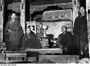 Norbulingka - Monks in front of the throne of the Dalai Lamas, Norbulingka. 1938.
