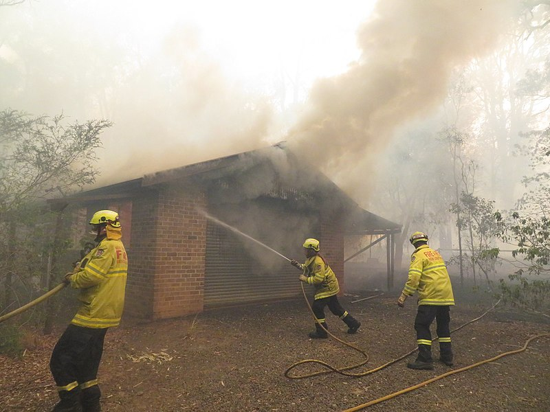 """""""Bushfire destroys house"""" by Helitak430, Wikipedia is licensed under CC BY-SA 4.0"""