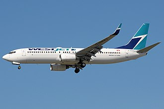 WestJet - A WestJet Boeing 737-800 landing in Vancouver