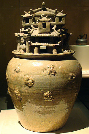 Hunping - A celadon hunping jar with sculpted designs of architecture, from the Jin Dynasty