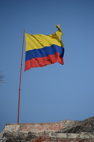 Flag of Colombia - Flag of Colombia atop Castillo San Felipe de Barajas in Cartagena, Colombia.