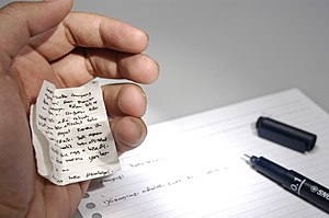 Cheating - A small cheat sheet can be used to cheat during an academic examination.