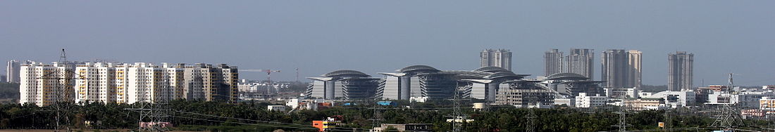 Panorama of TCS complex in Siruseri IT Park with housing projects nearby