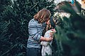 Christmas tree lot kiss (Unsplash).jpg