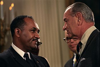 English: President Lyndon B. Johnson and Clare...
