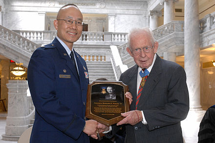 Fisher accepts Detachment 850 Distinguished Alumnus award Col Bernard F. Fisher - Det 850 Distinguished Alumnus.JPG