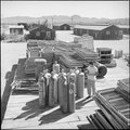 Colorado River Relocation Center, Poston, Arizona. There will be no more need for these army cots i . . . - NARA - 539896.tif