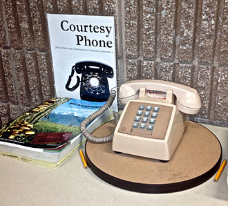 Courtesy telephone - Courtesy phone, telephone book, and pencils - Missoula Public Library, Missoula, Montana.
