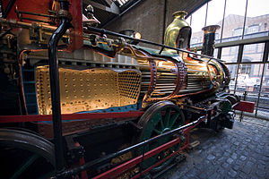 External combustion engine - Sectioned steam locomotive. Although the fire is within an enclosed firebox, this is still an external combustion engine, as the exhaust gas and the steam working fluid are kept separate.