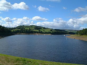 Damflask Reservoir - Damflask Reservoir seen from the dam wall with the hill of Ughill Heights in the background.