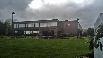 San Francisco 49ers - The headquarters of The DeBartolo Corporation in Boardman, Ohio with the 49ers logo on the building, signifying the team's ownership by the Youngstown-based DeBartolo-York family.