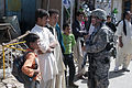 Defense.gov News Photo 100826-F-9208L-001 - U.S. Air Force Lt. Col. Curtis Velasquez 2nd from right commander of the Kapisa Provincial Reconstruction Team speaks with residents of Shawani.jpg