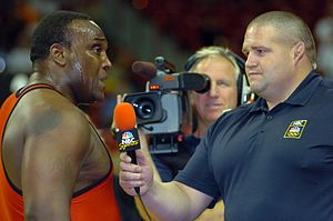 Rulon Gardner - Gardner (right) interviews Dremiel Byers in 2008, working as an analyst for MSNBC Sports.
