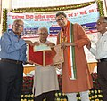 Deo Shankar Navin, being awarded by the great poet Kedarnath Singh by Vidyapati Samman of Bihar Government in Patna.jpg
