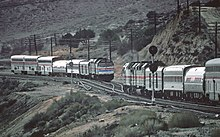 Two trains meet in a valley