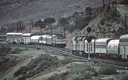 Two Desert Wind trains meet on the east side of Cajon Pass in 1981 Desert Winds meet at Lugo, California, February 1981.jpg