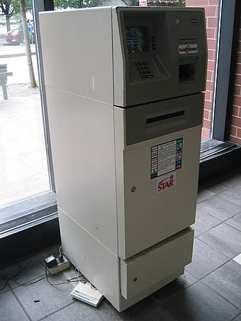 A Diebold 1063ix with a dial-up modem visible at the base Diebold 1063 ATM with modem.jpg