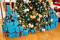 Dozens of blue gifts placed under Christmas tree - panoramio.jpg