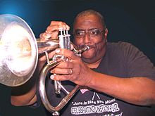 Dr. Myers plays the flugelhorn at a performance in Roland, Oklahoma.jpg