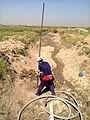 Drilling a hand dug well inside the river 04.jpg